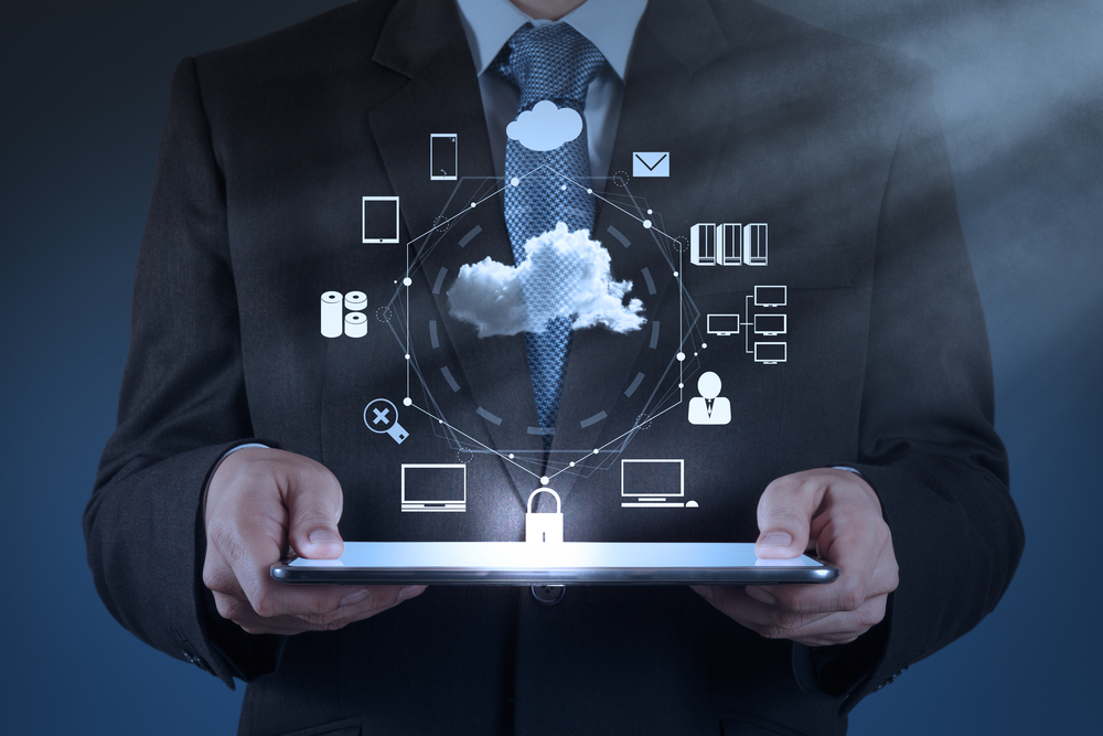 Businessman hand working with a Cloud Computing diagram on the new computer interface as concept