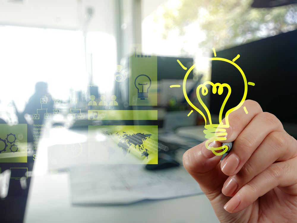 hand drawing creative business strategy with light bulb as concept-1